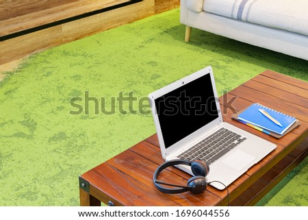 Photo of Personal computer, notebook, and business work materials in the coworking space (telework image)