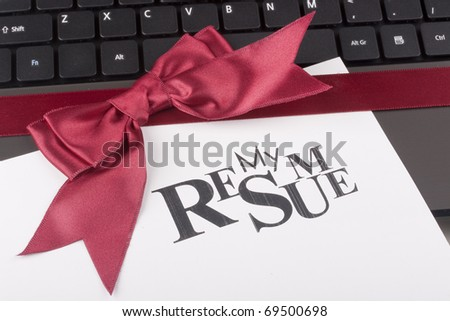 Personal computer tied a red ribbon with a bow and the words my resume.