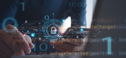 Personal data protection, antivirus software development, internet network, cyber security concept. Man using mobile phone with virtual padlock and technology icons and computer code on virtual screen