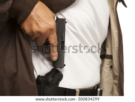 PERSONAL DEFENSE | Concealed Carry gun in holster on belt.  Mature adult with firearm or pistol.