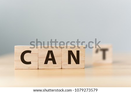 Personal development and career growth or change attitude yourself concept. Wood block cube with word CAN  #1079273579