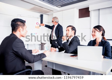 Personal development, coaching and training course for Business teamwork. Meeting and discussing with colleagues in conference room. #1196797459