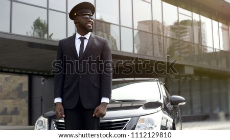Personal driver waiting for arrival of boss at airport, transfer service
