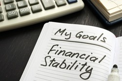 Personal goal - financial stability inscription on the sheet.