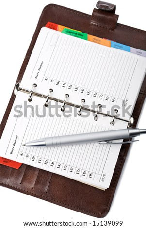 personal leather organizer and pen isolated