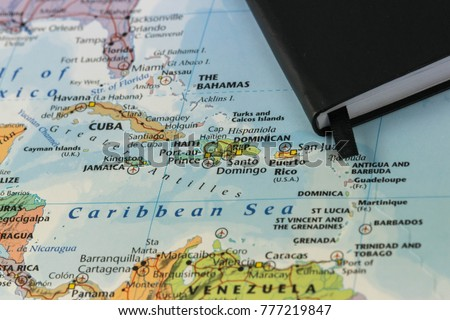 personal notes of someone planning a trip to the caribbean sea over a closeup map of Cuba, Haiti, Jamaica, Dominican, puertorico and the Bahamas #777219847