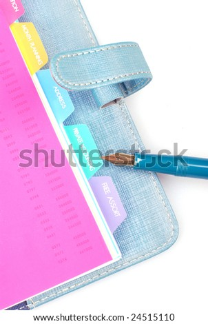 Personal organizer and pen on white background