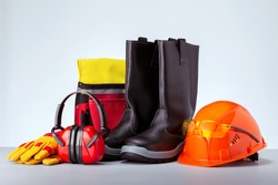 Personal protection equipment against grey background. Concept work safety.