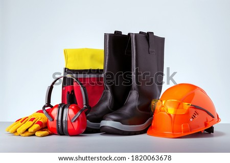 Personal protection equipment against grey background. Concept work safety.  Foto stock ©