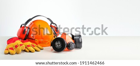 Personal protection equipment on gray surface with copy space. Job safety concept. Foto stock ©