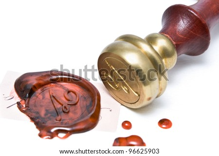 Personal stamp and wax seal isolated on white