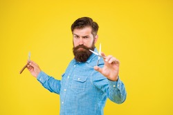 Personal stylist barber. Bearded man hold razor and scissors. Classy and fabulous. Retro barbershop. Hipster with tools. Designing haircut. Fresh hairstyle. Barbershop concept. Barbershop salon.