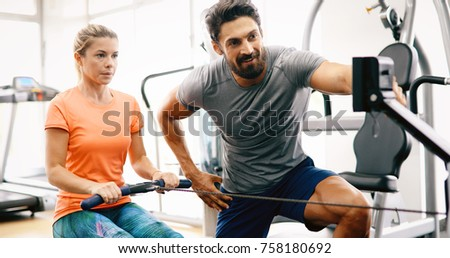 personal trainer assisting...