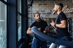 Personal training with a trainer on a treadmill.