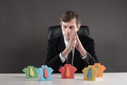 Personnel change. The boss reflects on the background of colorful origami men. Career ladder. Rational use of labor resources. HR manager.