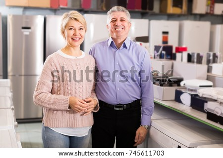 Persons are visiting shop of household appliances for buying goods for kitchen and house.  #745611703