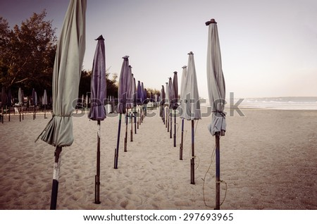 perspective  beach umbrella  on beach  vintage tone