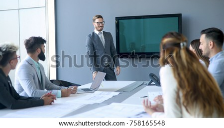 Perspective businesspeople having meeting in conference room #758165548