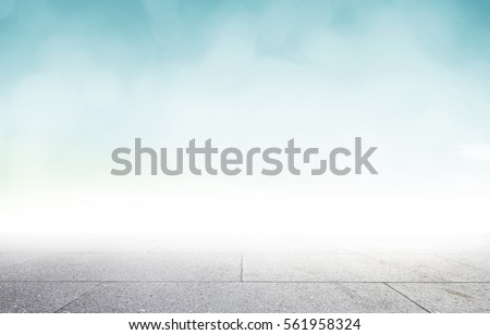 Perspective cement table shelf on therapy spring wallpaper teal color background over blurry blue sky concept for road pattern, hope christmas texture, cloud Relax turquoise garden floor summer shot