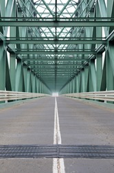 Perspective of a metal bridge, inside construction, road and double lane