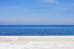 Perspective of a wooden berth, sea and blue sky. Seascape.  Concept of serenity