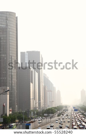 Perspective of avenue in haze at evening, Beijing, China