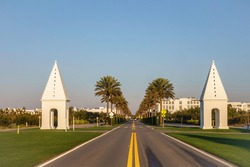 Perspective of East County Highway 30A between two steepled, iconic white landmarks (called