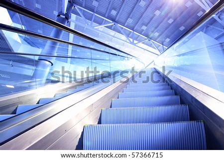 Perspective of escalator toned in blue color