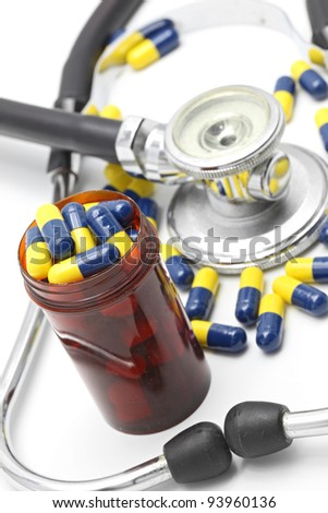 Perspective of Medical Stethoscope and Capsule on white background for Healthy Concept (selective focus at Pillbox)
