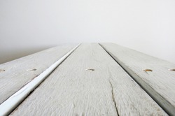 Perspective of three white sheets of rustic wood on white 3D space background for mockup. Rustic wood planks pattern. Design concept.