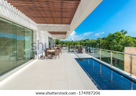 Perspective, outlook at the modern stylish restaurant, cafe, bar on the balcony, deck, patio of the luxury Mexican resort. Exterior, interior design. #174987206