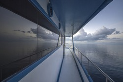 Perspective reflection of the sea on the boat...Maldives