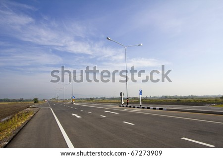 Perspective road yellow dot line and white line - stock photo
