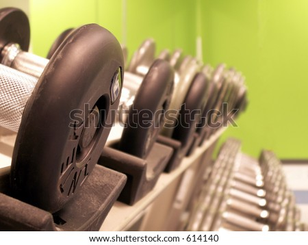 perspective shot of freeweights on the rack in a fitness center