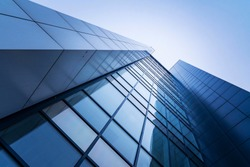 perspective, the skyscraper is directed to the sky. blue gradient, light reflection in glass, urban building design
