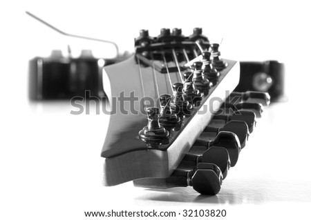 Perspective view of a black electric guitar.