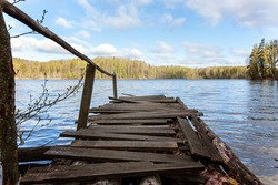 Perspective view of a old vintage wooden pier in a lake
