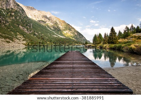 stock photo perspective view of a wooden pier in a mountain lake 381885991 - Каталог - 3d фотообои