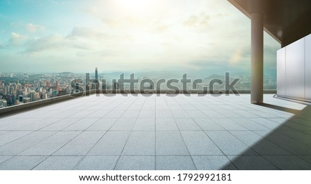 Perspective view of empty concrete tiles floor of rooftop with city skyline, Morning scene