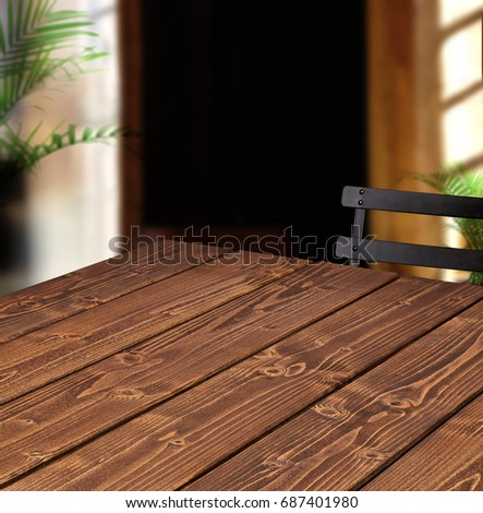 Perspective view of empty or blank wooden table corner at cafe