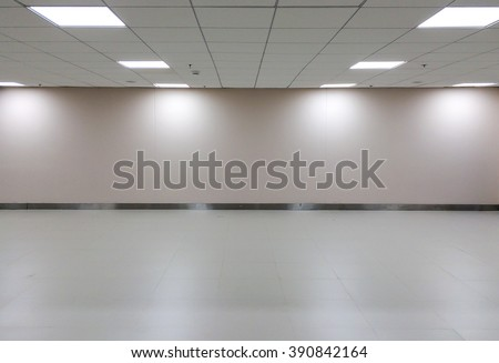 Perspective view of Empty Space of Classic White Office Room with Row of Ceiling Light Lamp and Lights Shade on The Wall for Gallery Interior or Used as Template to Mock Up or Display Office Furniture
