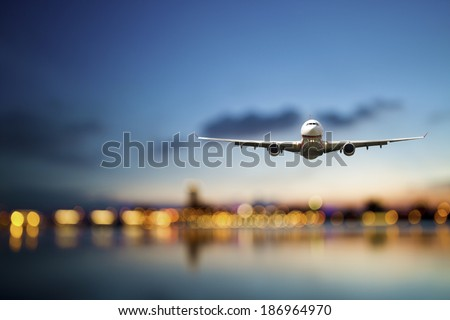 perspective view of jet airliner in flight with bokeh background - Shutterstock ID 186964970