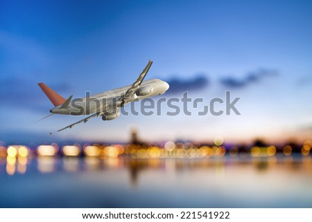 perspective view of jet airliner in flight with bokeh background - Shutterstock ID 221541922
