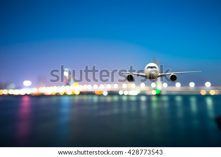 perspective view of jet airliner in flight with bokeh background - Shutterstock ID 428773543