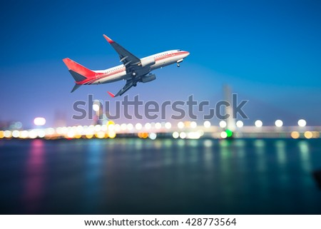 perspective view of jet airliner in flight with bokeh background - Shutterstock ID 428773564