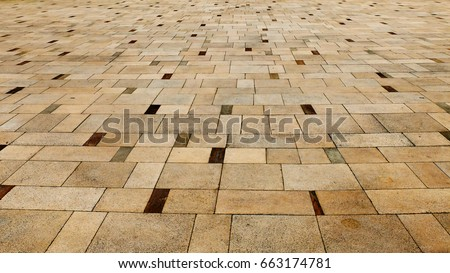 Perspective View of Light Brown Grunge Cracked Brick Marble Stone on The Ground for Street Road. Sidewalk, Driveway, Pavers, Pavement in Vintage Design Flooring Square Pattern Texture Background