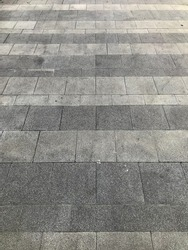 Perspective view of monotone Gray brick stone on the ground for sidewalk.
