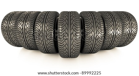 Perspective view of seven new car wheels isolated on the white background. Front view
