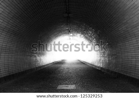Perspective View Through a Dark Tunnel With the Light at The End