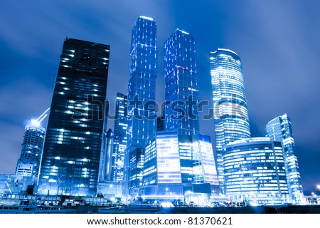 perspective view to glass high-rise skyscrapers of Moscow city business center at night